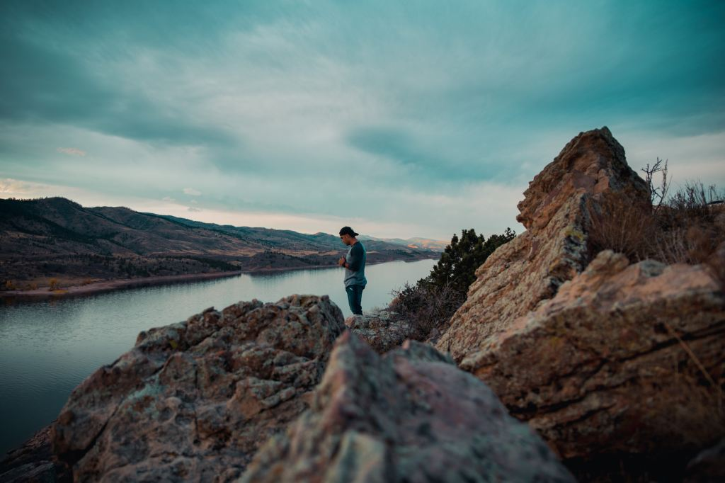 Photo of man standing near water at Horsetooth Reservoir Fort Collins, Colorado