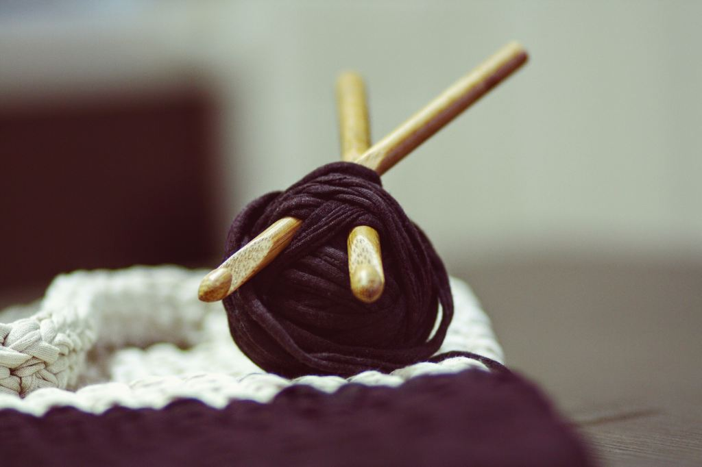 yarn ball and wooden needles